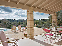 The large covered terrace has an al-fresco dining area and spectacular views over the Majorcan countryside