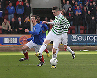 Mark Barrowman passing under pressure from Ryan Hardie in the Celtic v Rangers City of Glasgow Cup Final match played at Firhill Stadium, Glasgow on 29.4.13,  organised by the Glasgow Football Association and sponsored by City Refrigeration Holdings Ltd..