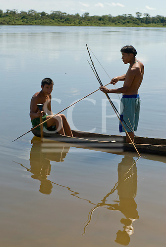 Xingu Indigenous Park, Mato Grosso State, Brazil. Aldeia Tuirarare (Kaiabi). Fishing with bows and arrows in the main river is practically impossible because the sediment in the water makes it impossible to see the fish.