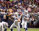 October 25, 2009 - St Louis, Missouri, USA - Colts guard Kyle DeVan (66) blocks Rams defensive end C.J. Ah You as quarterback Peyton Manning (18) throws a pass in the game between the St Louis Rams and the Indianapolis Colts at the Edward Jones Dome.  The Colts defeated the Rams 42 to 6.  .