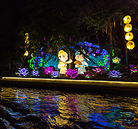Nanjing, Jiangsu, China. Night Cruise on the Qinhuai River, Illuminated Figures on the River Bank.