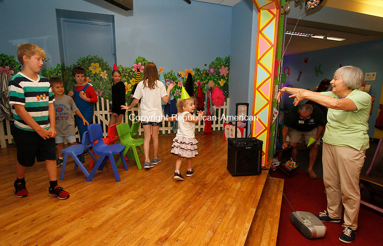 TORRINGTON, CT - 08 AUGUST 2017 - 080517JW01.jpg -- Play Facilitator Patty Cassella directs children in a game ofmusical chairs during the KidsPlay Children's Museum 5th anniversary Saturday morning.  Jonathan Wilcox Republican-American
