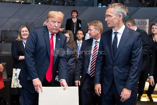 11 July 2018, Brussels, Belgium: Donald Trump (L), President of the United States of America, and Jens Stoltenberg, NATO Secretary General, arrive at the first work session of the North Atlantic council at the NATO Summit. From 11 July 2018 until 12 July 2018 government heads of the 29 NATO member states and European Union representatives, will participate in the Summit of the North Atlantic Treaty Organization. Photo: Bernd von Jutrczenka/dpa /MediaPunch ***FOR USA ONLY***