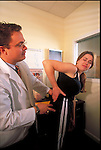 patient describing pain to chiropractor