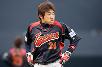 19 March 2009: #24 Seiichi Uchikawa of Japan warms up prior to the 2009 World Baseball Classic Pool 1 game 6 at Petco Park in San Diego, California, USA. Japan wins 6-2 over Korea.