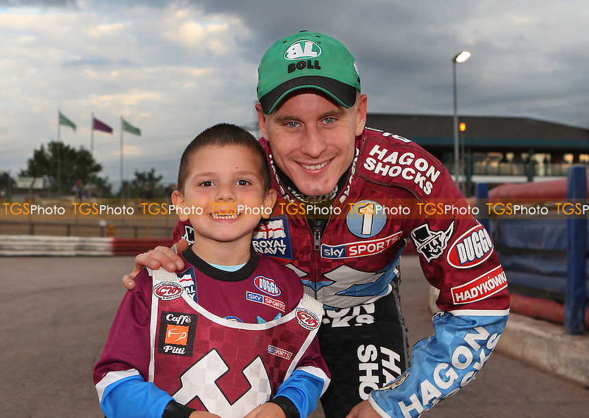 Lee Richardson with the Lakeside Hammers mascot for the evening - Lakeside Hammers vs Poole Pirates, Elite League Speedway at the Arena Essex Raceway, Purfleet - 22/07/11 - MANDATORY CREDIT: Rob Newell/TGSPHOTO - Self billing applies where appropriate - 0845 094 6026 - contact@tgsphoto.co.uk - NO UNPAID USE.