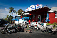 The rustic Joanie's Blue Crab Cafe along the Tamiami Trail in the Everglades, offers up servings of Blue Crab, Alligator Bites smothered in garlic and other 'swamp' food, while taking in the local entertainment. Photo by Debi Pittman Wilkey