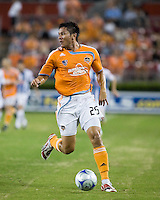 Houston Dynamo forward Brian Ching (25) advances the ball.  Houston Dynamo defeated Pachuca FC 2-0 in the semifinals of the Superliga 2008 tournament at Robertson Stadium in Houston, TX on July 29, 2008.