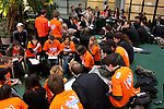Youth populate the Conference center in their orange shirts for Youth and Future Generations Day. (Images free for Editorial Web usage for Fresh Air Participants during COP 15. Credit: Robert vanWaarden)