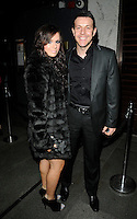 GUEST & LEE LATCHFORD EVANS .At the Active Harry new campaign launch party, Embassy nightclub, London, England, UK, .February 9th 2011..full length black jacket shirt suit fur coat grey gray .CAP/CAN.©Can Nguyen/Capital Pictures.