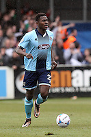 Aristote Nsiala of Grimsby Town during the Vanarama National League match between Dover Athletic and Grimsby Town at the Crabble Athletic Ground, Dover, England on 16 April 2016. Photo by Tony Fowles/PRiME Media Images.