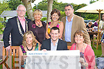 Ger O'Brien of the Communications Workers Union  presenting a donation of EUR1,000 to the Hospice fundraiser at a Garden party in aid of the Hospice at Ballygarry house hotel on Sunday were Front row from left: Nuala Finnegan, Ger O'Brien and Mairead Moriarty. Back row from Left: Martin Hoban President of Rotary, Deirdre McElligott, Margaret O'Shea and George Phillips.