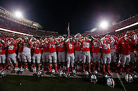 Ohio State players sing Carmen Ohio following their 63-14 win over Penn State during the NCAA football game at Ohio Stadium in Columbus on Oct. 26, 2013. (Adam Cairns / The Columbus Dispatch)