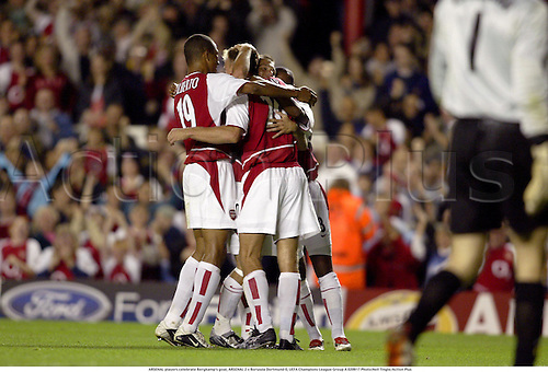 ARSENAL players celebrate Bergkamp's goal, ARSENAL 2 v Borussia Dortmund 0, UEFA Champions League Group A 020917 Photo:Neil Tingle/Action Plus...Soccer Football 2002.Premier league premiership.celebrate celebration celebrations joy..