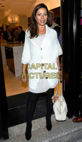 CLARE NASIR .3-Synergy launch party, Intervari, London, England..September 30th, 2010.full length white coat cardigan knitted black tights bag purse .CAP/CJ.©Chris Joseph/Capital Pictures.