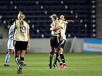 FC Gold Pride forward Christine Sinclair (12), who scored the game winning goal, gets a hug from teammate Kristen Graczyk (13) after the FC Pride victory.  The defeated the FC Gold Pride defeated the Chicago Red Stars 1-0 at Toyota Park in Bridgeview, IL on May 16, 2009.