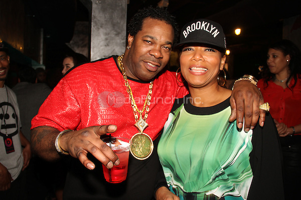 LOS ANGELES, CA - JANUARY 24: Busta Rhymes, Queen Latifah backstage at the Beats Music Official Launch Party from Beats by Dr. Dre at Belasco Theatre on January 24, 2014 in Los Angeles, California. Credit: Walik Goshorn/MediaPunch