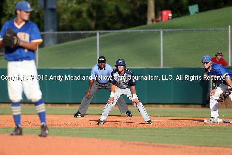 31 May 2016: Nova Southeastern's Dylan Woods (center) takes a lead off of first base while being watches by Lander's Will Jones (left) and Colby Lusignan (right). The Nova Southeastern University Sharks played the Lander University Bearcats in Game 8 of the 2016 NCAA Division II College World Series  at Coleman Field at the USA Baseball National Training Complex in Cary, North Carolina. Nova Southeastern won the game 12-1.