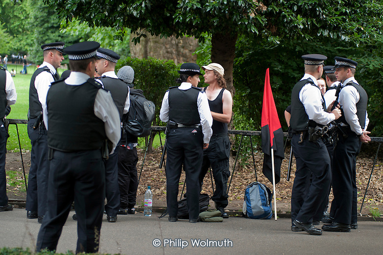 Police search Black Bloc anarchists in Lincoln's Inn Fields before a demonstration by striking public sector worker over planned pension changes.