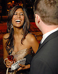 Divya Paralkar laughs with her date Chris Brown at the Houston Grand Opera's Opening Night dinner Friday Oct. 23,2009. (Dave Rossman/For the Chronicle)