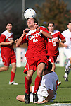 15 November 2009: NC State's Lucas Carpenter heads the ball. The University of Virginia Cavaliers defeated the North Carolina State University Wolfpack at WakeMed Stadium in Cary, North Carolina in the Atlantic Coast Conference Men's Soccer Tournament Championship game.