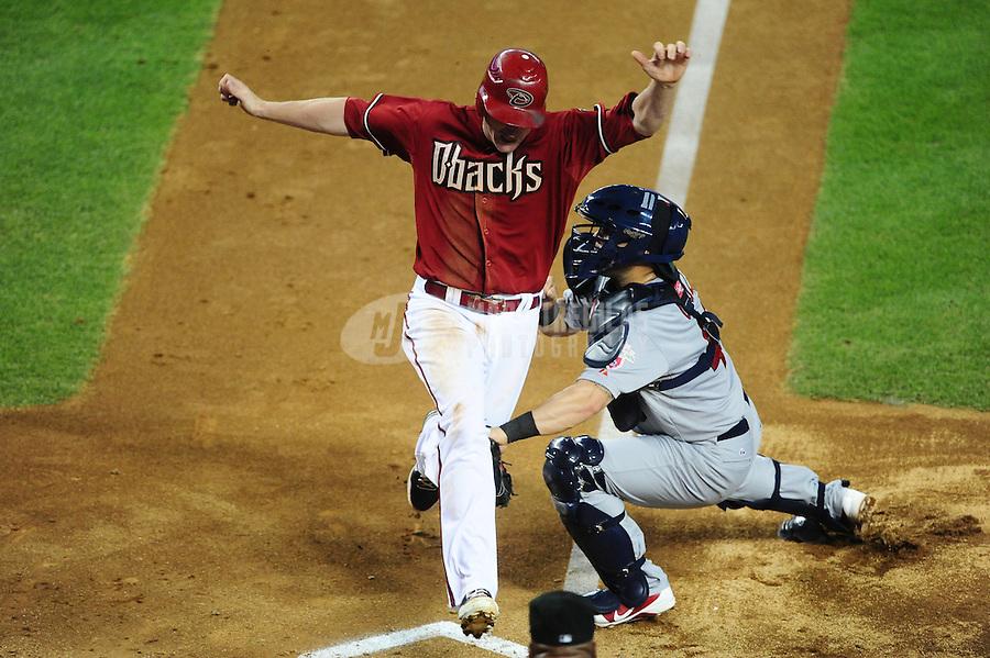 May 9, 2012; Phoenix, AZ, USA; St. Louis Cardinals catcher Tony Cruz (right) tags out Arizona Diamondbacks base runner Lyle Overbay in the fourth inning at Chase Field. Mandatory Credit: Mark J. Rebilas-