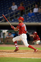 Philadelphia Phillies shortstop J.P. Crawford (12) hits a single in the bottom of the seventh inning during a game against the Florida Fire Frogs while on rehab assignment with the Clearwater Threshers on June 1, 2018 at Spectrum Field in Clearwater, Florida.  Florida defeated Clearwater 12-10.  (Mike Janes/Four Seam Images)