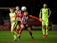 Lincoln City's Tyler Walker vies for possession with Bolton Wanderers' Ronan Darcy<br /> <br /> Photographer Chris Vaughan/CameraSport<br /> <br /> The EFL Sky Bet League One - Lincoln City v Bolton Wanderers - Tuesday 14th January 2020  - LNER Stadium - Lincoln<br /> <br /> World Copyright © 2020 CameraSport. All rights reserved. 43 Linden Ave. Countesthorpe. Leicester. England. LE8 5PG - Tel: +44 (0) 116 277 4147 - admin@camerasport.com - www.camerasport.com