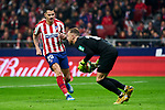 Victor Machin 'Vitolo' of Atletico de Madrid and Aaron Escandell of Granada CF during La Liga match between Atletico de Madrid and Granada CF at Wanda Metropolitano Stadium in Madrid, Spain. February 08, 2020. (ALTERPHOTOS/A. Perez Meca)