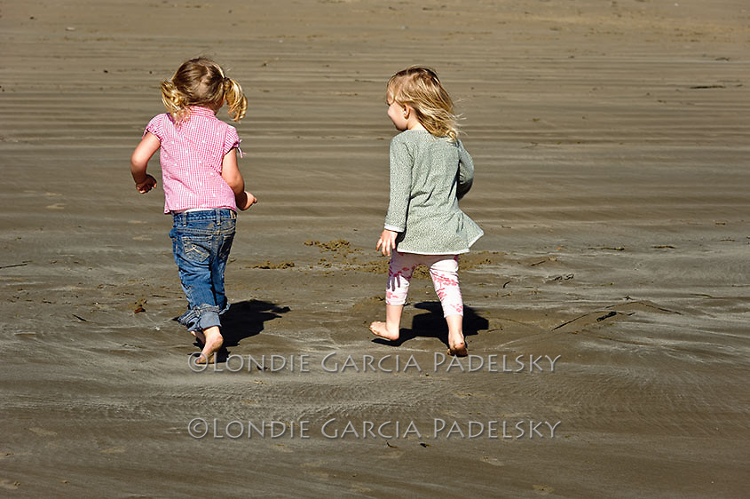Two Little Girls Walking on Beach