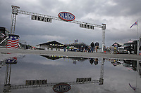 May 3, 2013; Commerce, GA, USA: Rain puddles in the NHRA nitro alley pit area during a ran delay to qualifying for the Southern Nationals at Atlanta Dragway. Mandatory Credit: Mark J. Rebilas-