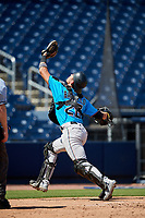 Miami Marlins catcher Will Banfield (26) catches a foul ball popup during an Instructional League game against the Washington Nationals on September 26, 2019 at FITTEAM Ballpark of The Palm Beaches in Palm Beach, Florida.  (Mike Janes/Four Seam Images)