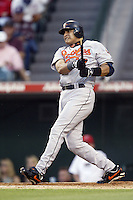 Geronimo Gil of the Baltimore Orioles bats during a 2002 MLB season game against the Los Angeles Angels at Angel Stadium, in Los Angeles, California. (Larry Goren/Four Seam Images)