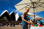 A woman shopping for souvenirs at the Sydney Opera House markets.  Sydney, New South Wales, AUSTRALIA