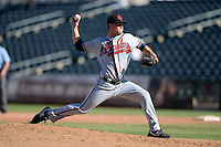 Scottsdale Scorpions pitcher Shae Simmons (26), of the Atlanta Braves organization, during an Arizona Fall League game against the Surprise Saguaros on October 17, 2013 at Surprise Stadium in Surprise, Arizona.  Surprise defeated Scottsdale 10-5.  (Mike Janes/Four Seam Images)