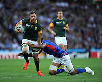 Duane Vermeulen of South Africa forces his way through the tackle attempt of Teofilo Paulo of Samoa during Match 15 of the Rugby World Cup 2015 between South Africa and Samoa - 26/09/2015 - Villa Park, Birmingham<br /> Mandatory Credit: Rob Munro/Stewart Communications