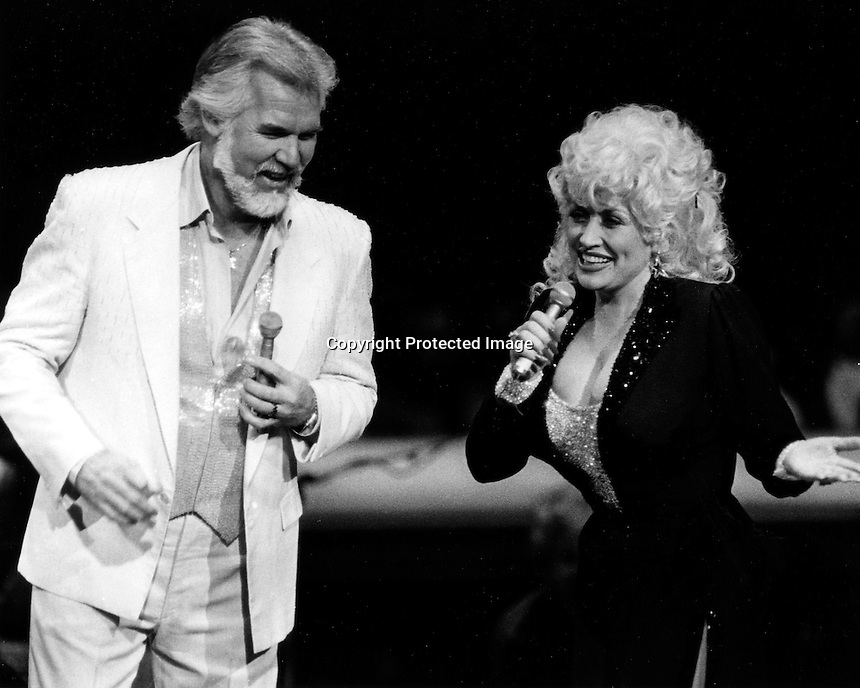 Kenny Rogers and Dolly Parton intertaining in Concert in Oakland, Ca 1980's (photo by Ron Riesterer)