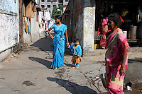 A woman and child wearing a matching shade of blue in a community in central Kolkata.<br />