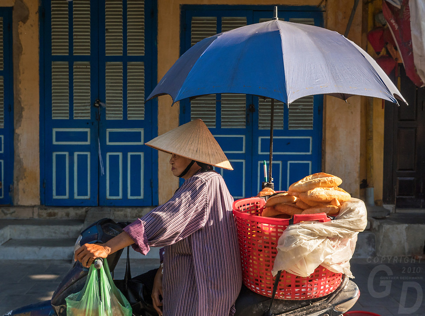 Selling Baguettes in the Old Town Hội An, the city's historic district, is recognized as an exceptionally well-preserved example of a South-East Asian trading port dating from the 15th to the 19th century and is a world UNESCO heritage Site.