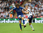 Tottenham's Christian Eriksen tussles with Chelsea's David Luiz during the premier league match at the Wembley Stadium, London. Picture date 20th August 2017. Picture credit should read: David Klein/Sportimage