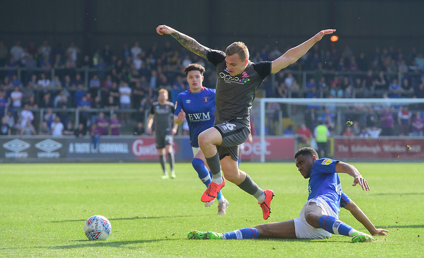 Lincoln City's Harry Anderson vies for possession with Carlisle United's Kelvin Etuhu<br /> <br /> Photographer Chris Vaughan/CameraSport<br /> <br /> The EFL Sky Bet League Two - Carlisle United v Lincoln City - Friday 19th April 2019 - Brunton Park - Carlisle<br /> <br /> World Copyright © 2019 CameraSport. All rights reserved. 43 Linden Ave. Countesthorpe. Leicester. England. LE8 5PG - Tel: +44 (0) 116 277 4147 - admin@camerasport.com - www.camerasport.com