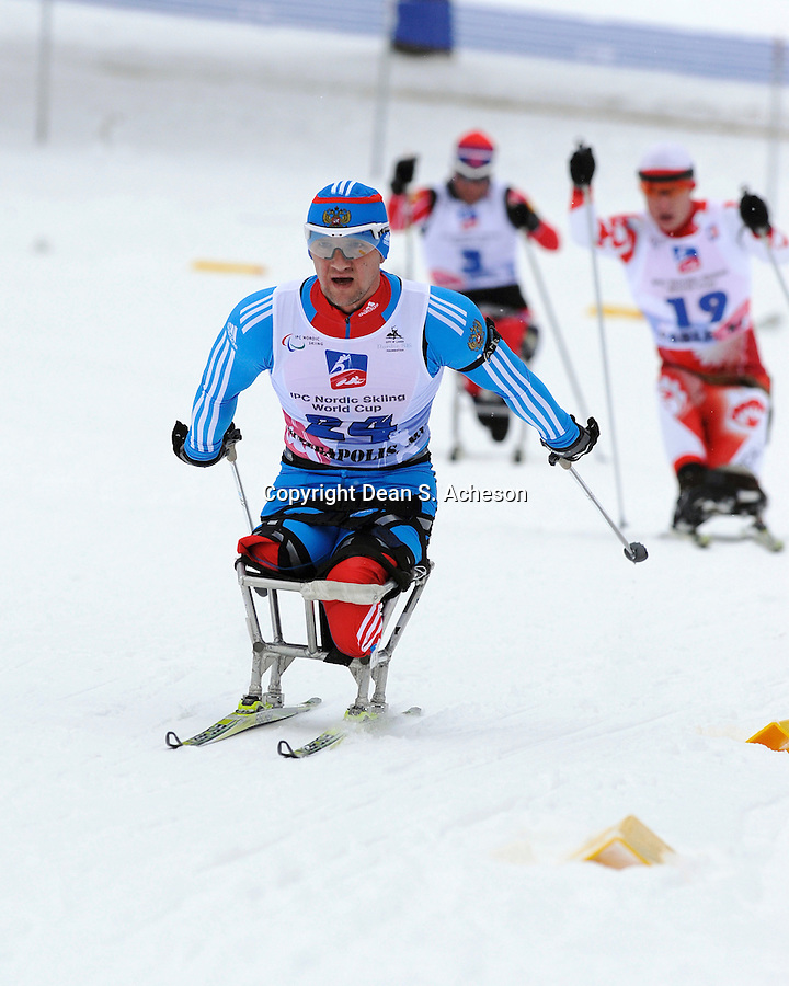 Roman Petushkov of Russia (25.10.6) builds momentum towards his win Saturday, Jan. 28, 2012 in the biathlon short distance race, besting the field of the 7.5KM LW 10-12 Men by just over two minutes. The IPC Nordic Skiing World Cup race was held at Telemark Resort, near Cable, WI.