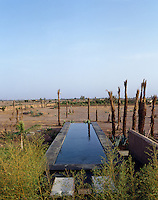 The lap pool which overlooks the dry hot landscape is a welcome respite in this desert landscape