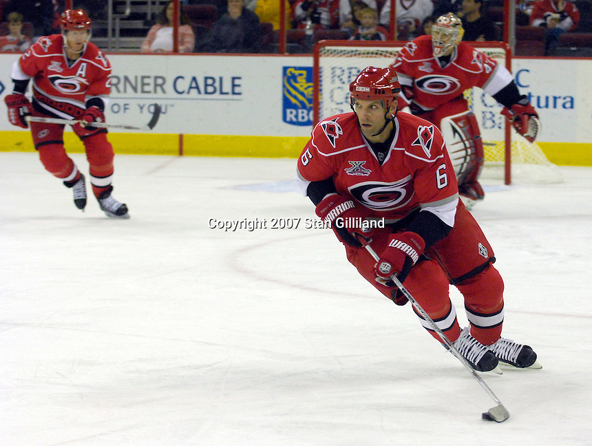 Carolina Hurricanes' defenseman Bret Hedican brings the puck up ice against the Montreal Canadiens during their game Friday, Oct. 26, 2007 in Raleigh, NC. The Canadiens won 7-4.