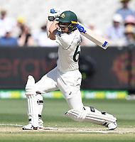 29th December 2019; Melbourne Cricket Ground, Melbourne, Victoria, Australia; International Test Cricket, Australia versus New Zealand, Test 2, Day 4; Travis Head of Australia hits the ball back down the wicket - Editorial Use