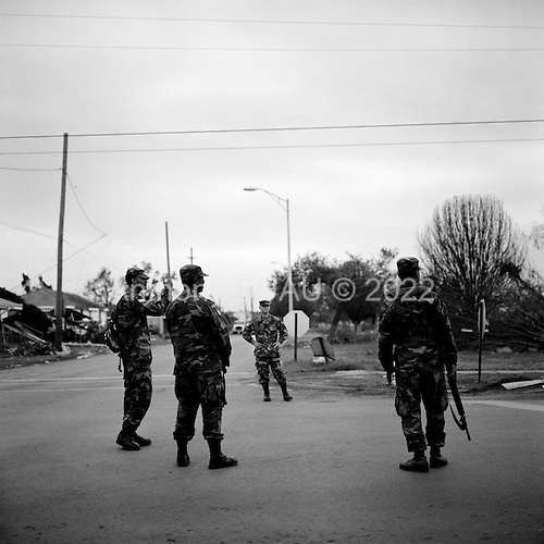 New Orleans, Louisianna.USA.December 1, 2005 ..Hurricane Katrina damage and recovery. As residents of the lower ninth ward return to their homes for the first time the National Guard and police petrol the area. .
