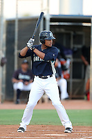 Gareth Morgan #18 of the AZL Mariners bats against the AZL Giants at Peoria Sports Complex on July 10, 2014 in Peoria, Arizona. (Larry Goren/Four Seam Images)