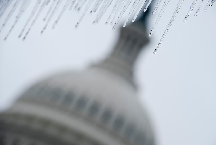 UNITED STATES - JANUARY 18: Icicles hang from the the roof of one of the old streetcar shelters on the East Plaza of the Capitol on Tuesday, Jan. 18, 2011, following an overnight snow and ice storm in the Washington area. (Photo By Bill Clark/Roll Call)
