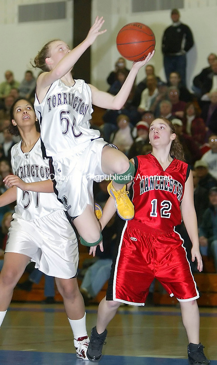 GLASTONBURY, CT, 03/06/07- 030607BZ12- Torrington's Michelle Royals (50) goes to the hoop against Manchester's Marci Reisman (12) during the Class LL semifinals at Glastonbury High School Tuesday. <br /> Jamison C. Bazinet Republican-American
