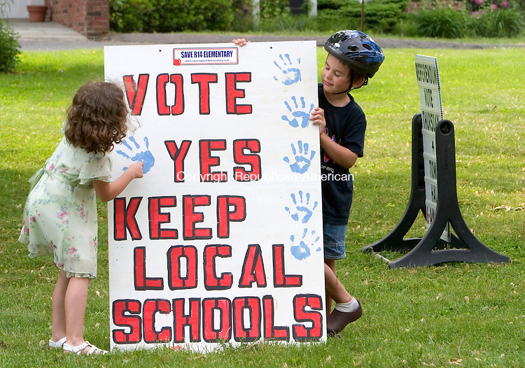 BETHLEHEM, CT- 31 MAY 2007- 053107JT03- <br /> <br /> Megan DeCicco, 7, and Leo Scherf, 6, display a sign in front of Bethlehem Town Hall on Thursday as voters entered the polling station to decide on an amendment proposed by the Save Region 14 Elementary group to amend the 1968 school regionalization plan. <br /> Josalee Thrift Republican-American